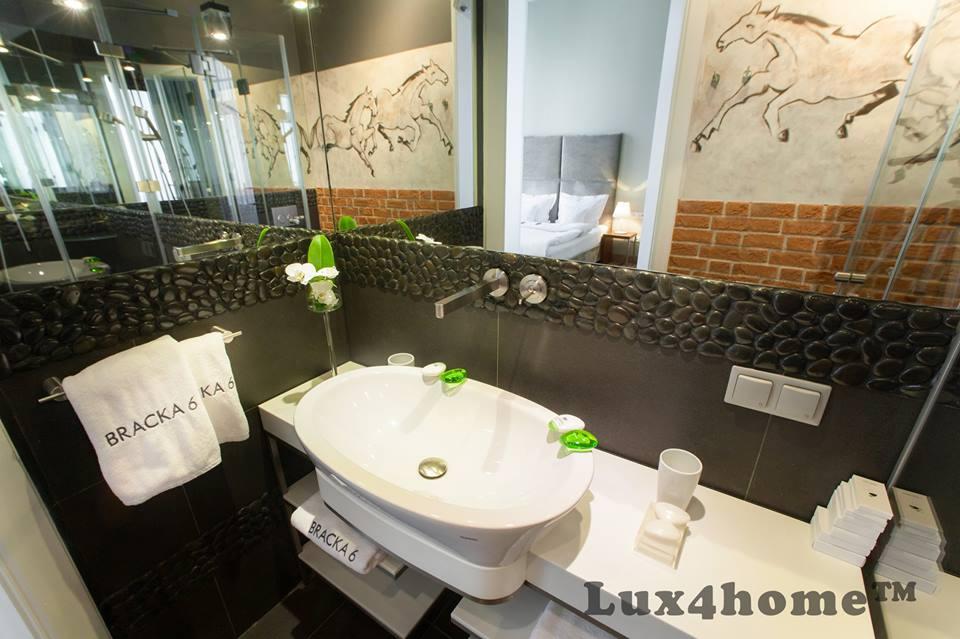 black pebble tiles bathroom
