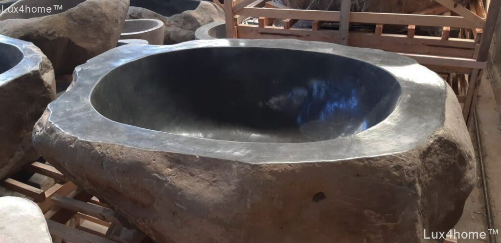 Basalt boulder bathtub - stone tubs