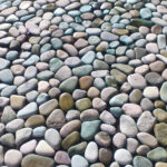 Green Color Pebbles on mesh