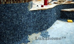 Black pebble pool - pebble tiles instalation