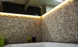 beige pebble tile wall bathroom