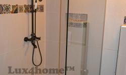 Beige Pebble Tile - Pebble shower wall