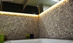 beige pebble tile wall bathroom