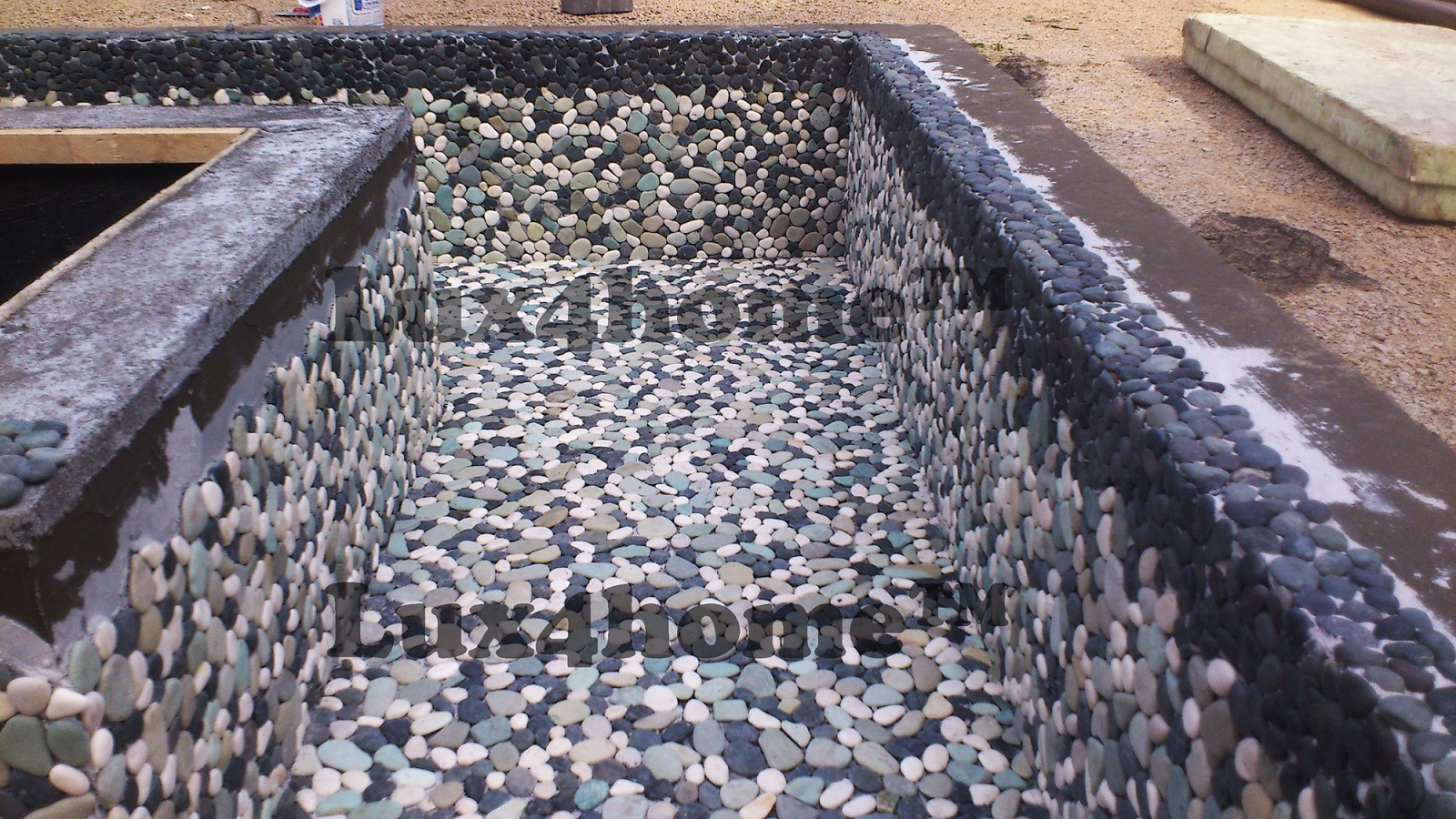Pebble Tile outdoor fountain pool