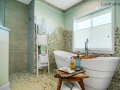 Green-and-White-Pebble-Tile-Bathroom-Floor-&-Wall